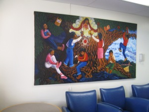 Large colorful painting above some cushy seating
