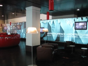The red ground floor Help Desk is on the left