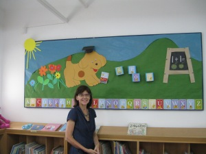 "Children's Librarian Dalena by ""Spot"" the mascot for the current Educate campaign"