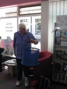 Visitor Carol Johnson Shedd demonstrating a different sort of basket
