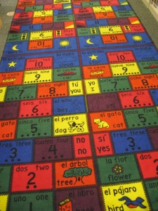 This vibrant rug teaches tots Spanish and English