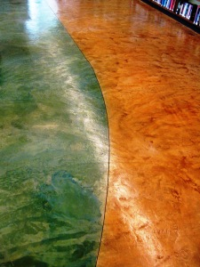 The green and tan floor symbolizes sand and sea and is truly a work of art