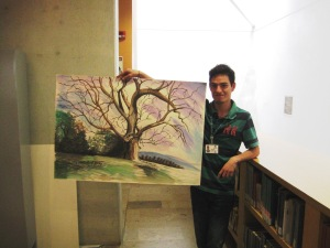 Juan with one of his paintings